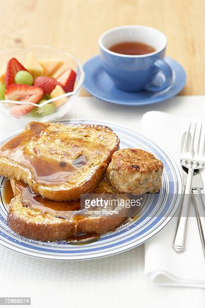Classic French toast with syrup, elevated view, close-up