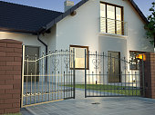 Classic Iron Gate and house