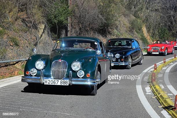 Classic Jaguar Mk II cars driving on the road