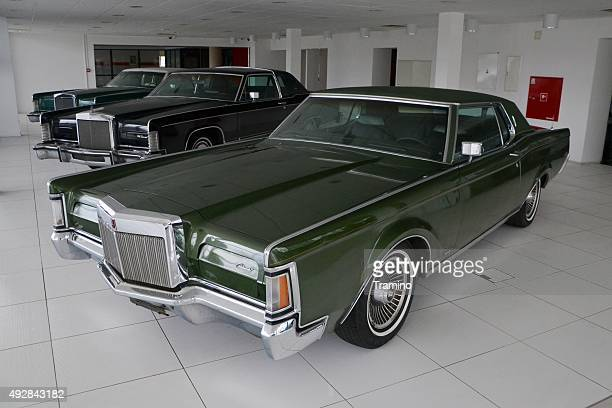 classic lincoln continental cars in a row - lincoln continental stock photos and pictures