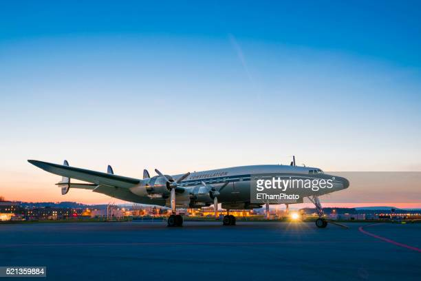 Classic Lockheed Super Constellation aircraft in the evening twilight at Zurich airport