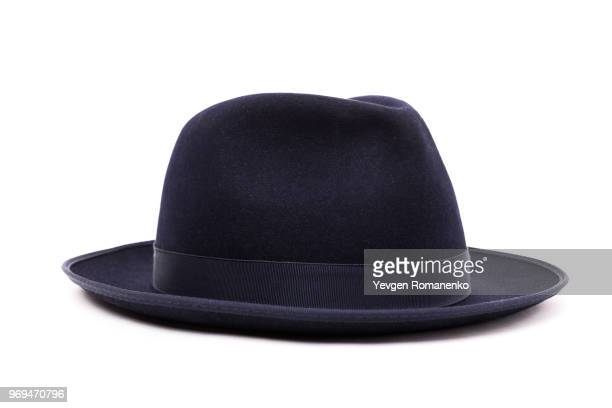 a classic low crown fedora hat in a dark blue color. isolated on white background. - cappello foto e immagini stock