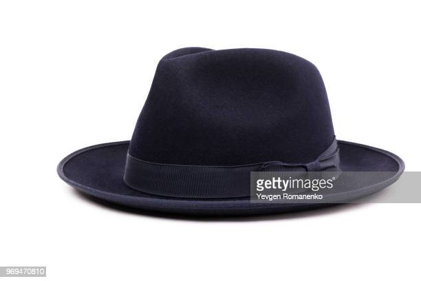 a classic low crown fedora hat in a dark blue color. isolated on white background. - white hat fashion item stock photos and pictures