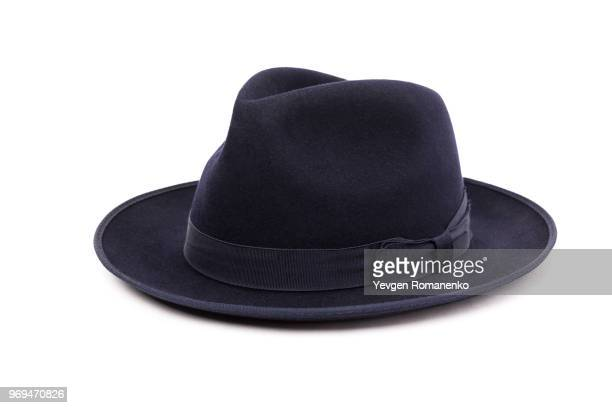 a classic low crown fedora hat in a dark blue color. isolated on white background. - fedora stock pictures, royalty-free photos & images