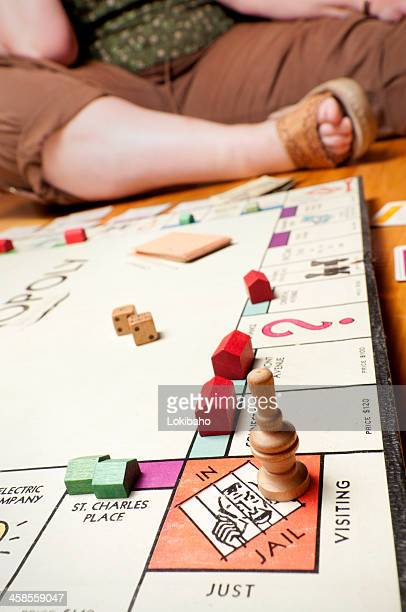 classic monopoly close up on the floor - game night stock photos and pictures