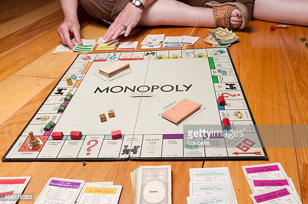 Classic Monopoly Game on the Floor Midgame