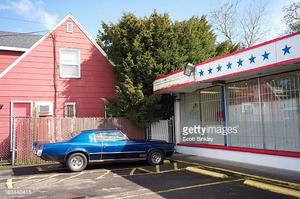 Classic muscle car parked in Portland Oregon corner store parking lout.