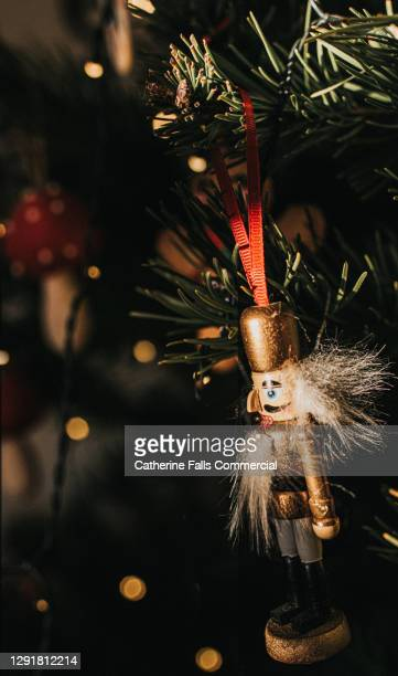 classic nutcracker hanging tree decoration on a christmas tree - symbolism stock pictures, royalty-free photos & images