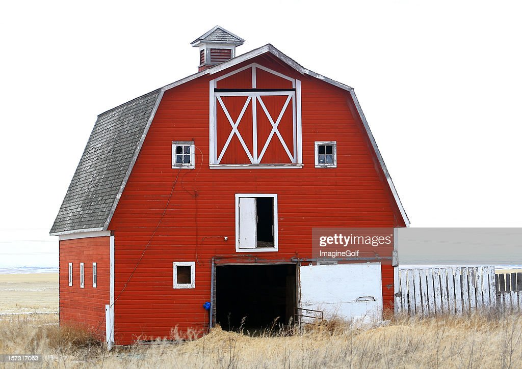 Classic Old Red Barn On The Great Plains In Winter Stock