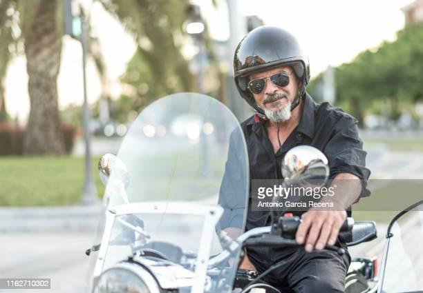 classic old sidecar senior biker in city bulevar - バイカー ストックフォトと画像