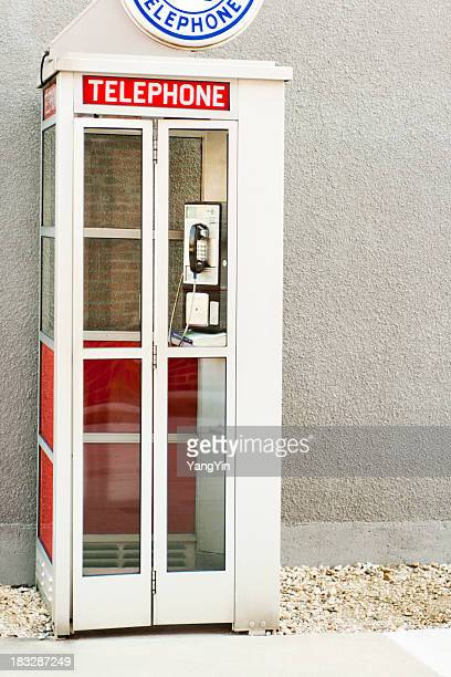 classic old-fashioned american phone booth by building wall - telephone booth stock pictures, royalty-free photos & images