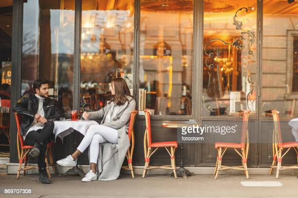 a classic parisian cafe - restaurant stock photos and pictures