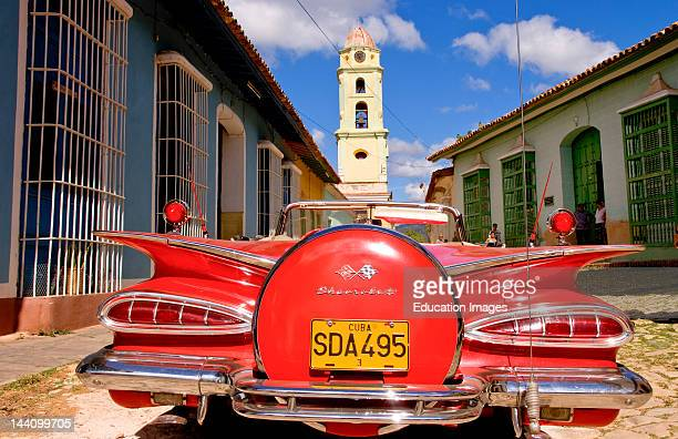 Classic Red 1959 Beautiful Chevy Convertible On Cobblestone Street Of Trinidad Cuba An Old Colonial Village