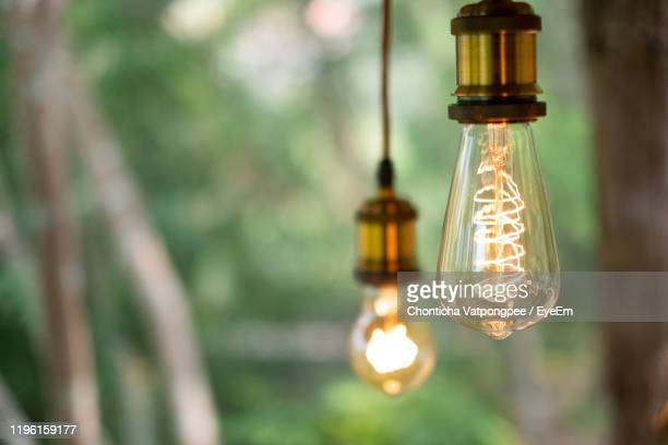 classic retro incandescent led electric lamp on blur background,vintage light bulb - led light stock pictures, royalty-free photos & images