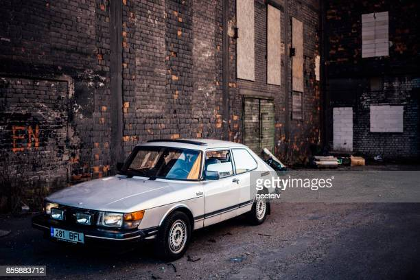 classic saab - abandoned car stock photos and pictures