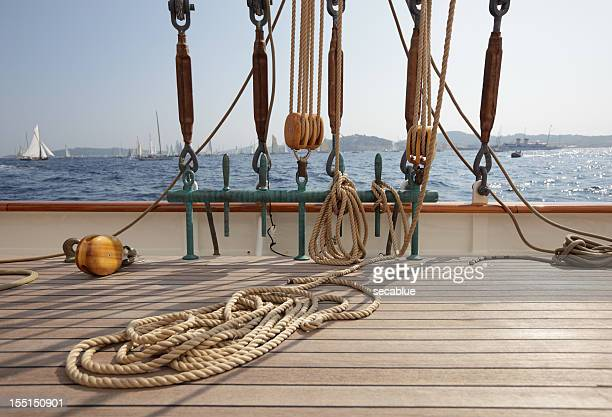 classic sailing yacht deck and view - pirate ship stock photos and pictures