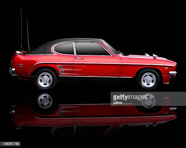 classic seventies sports car on black backgrou - 1970s muscle cars stock pictures, royalty-free photos & images