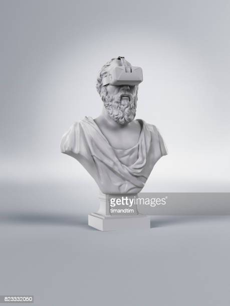 classic statue of a man wearing a vr headset - sculptuur stockfoto's en -beelden
