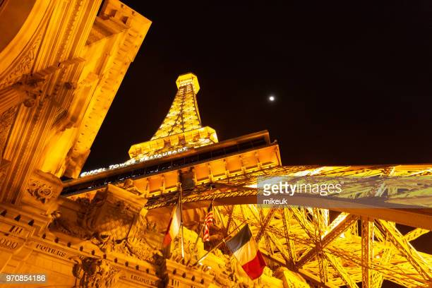 classic street scene from Las Vegas city, Nevada at night with the Paris Eiffel Tower reconstruction.