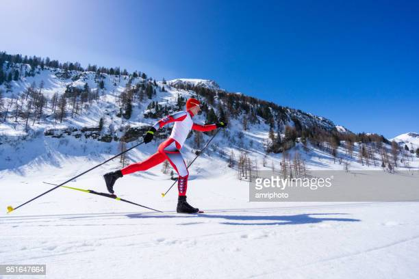 classic style cross country skiing man on sunny winters day - winter sports event stock pictures, royalty-free photos & images