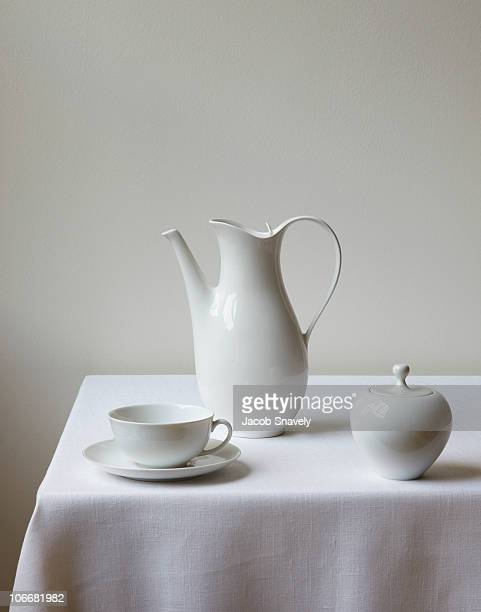 classic tea/coffee set on white linen table. - saucer stock pictures, royalty-free photos & images