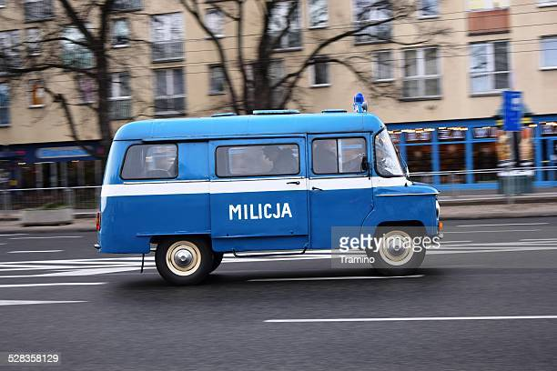 classic van from polish militia (old police) on the street - law enforcement appreciation stock pictures, royalty-free photos & images