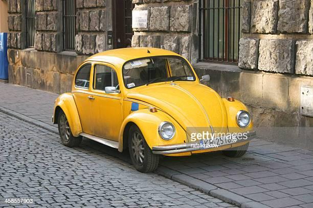 classic volkswagen beetle car - volkswagen beetle stock photos and pictures