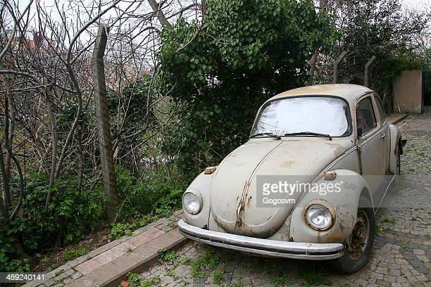 classic volkswagen beetle car - abandoned car stock photos and pictures