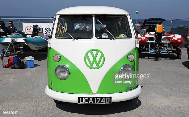 A classic Volkswagen camper van is parked in the Zapcat power boat team area as they are prepared for a practice race at Fistral Beach on April 23...