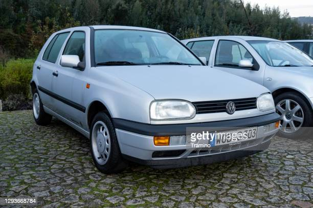 classic volkswagen golf iii on a parking - golf imagens e fotografias de stock