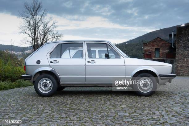 classic volkswagen golf on a street - golf imagens e fotografias de stock