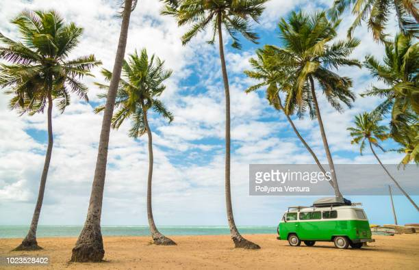 classic volkswagen kombi van on beach - volkswagen stock pictures, royalty-free photos & images