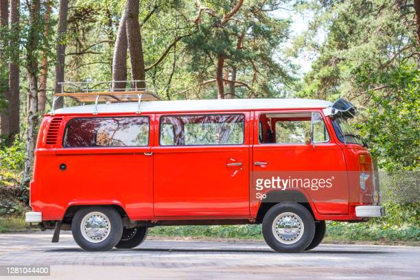 "classic volkswagen transporter t2 van of the second generation parked in a forest - ""sjoerd van der wal"" or ""sjo"" stock pictures, royalty-free photos & images"