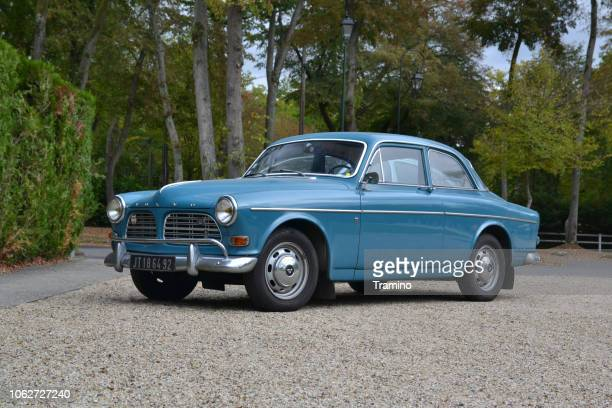 classic volvo amazon on the street - volvo stock pictures, royalty-free photos & images