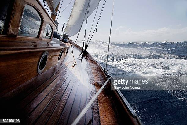classic yacht with water on the side deck - 船のデッキ ストックフォトと画像
