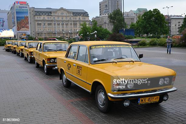 classic yellow taxis for tourists - polish culture stock photos and pictures
