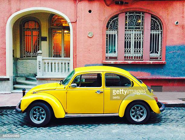 classic yellow volkswagen beetle - beetle stock pictures, royalty-free photos & images