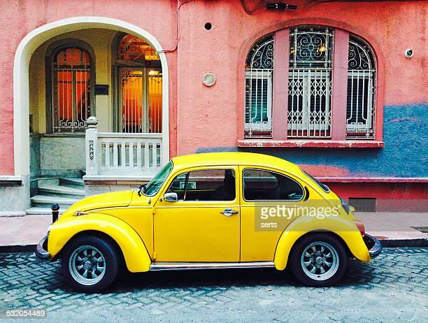 classic yellow volkswagen beetle - volkswagen beetle stock photos and pictures