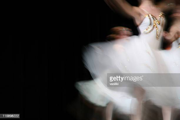 Classical ballet dancers in motion