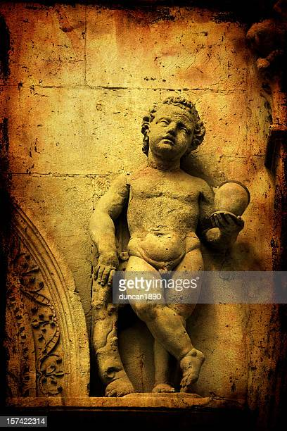 classical child statue - greek mythology stock pictures, royalty-free photos & images