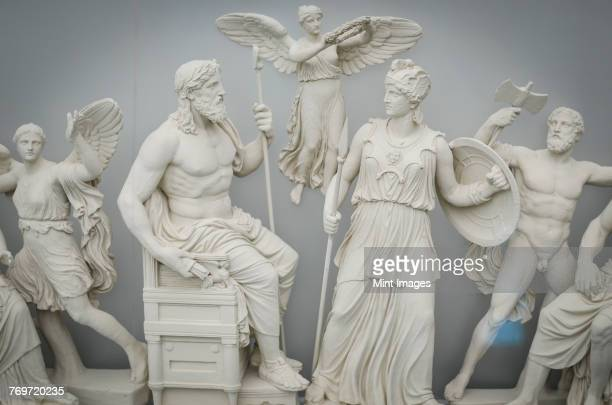 classical greek sculptures of gods and goddesses, athens, greece. - sculptuur stockfoto's en -beelden