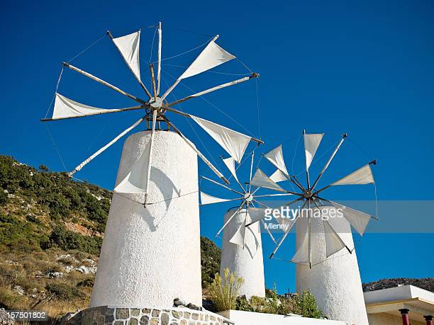 classical greek windmills - herakleion stock photos and pictures