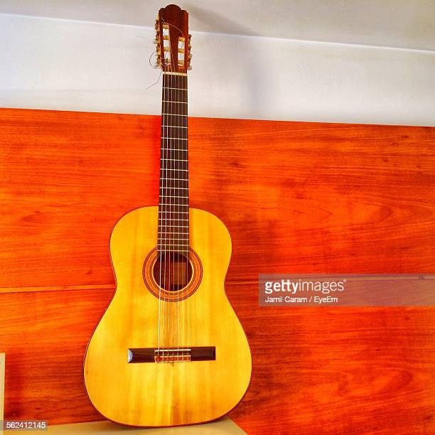 classical guitar on table against wall - classical guitar stock photos and pictures