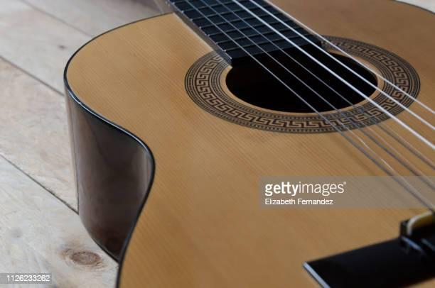 classical guitar on wooden background - chitarra classica foto e immagini stock
