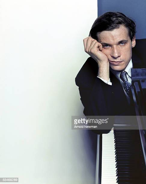 Classical pianist Glenn Gould poses for portrait with his piano October 10, 1959 in New York City.