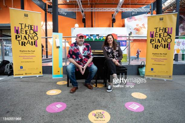 Classical pianist Kathryn Stott and Classic FM's More Music Breakfast show presenter Tim Lihoreau pose in Kirkgate Market during the Leeds Piano...