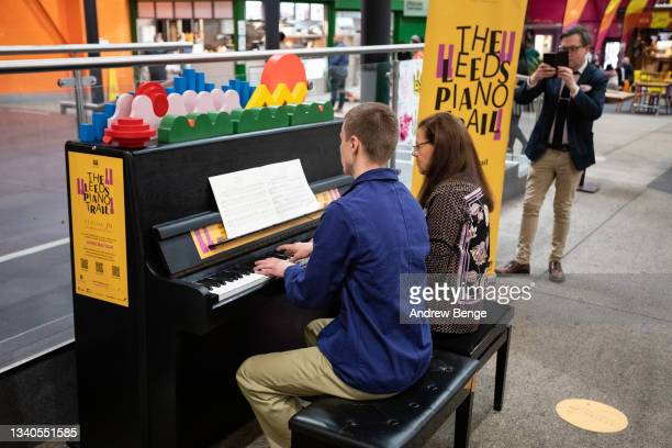 Classical pianist Kathryn Stott performs a duet with a memer of the public in Kirkgate Market during the Leeds Piano Trail 2021 on September 15, 2021...