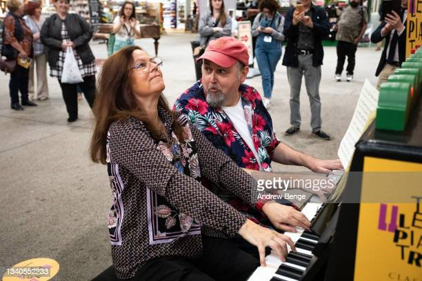Classical pianist Kathryn Stott performs a duet with Classic FM's More Music Breakfast show presenter Tim Lihoreau in Kirkgate Market during the...