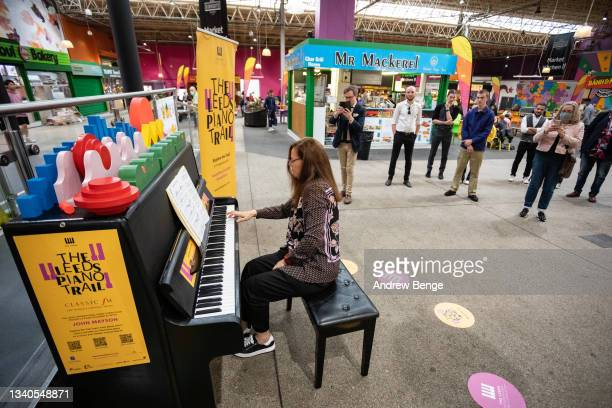Classical pianist Kathryn Stott performs in Kirkgate Market during the Leeds Piano Trail 2021 on September 15, 2021 in Leeds, England.