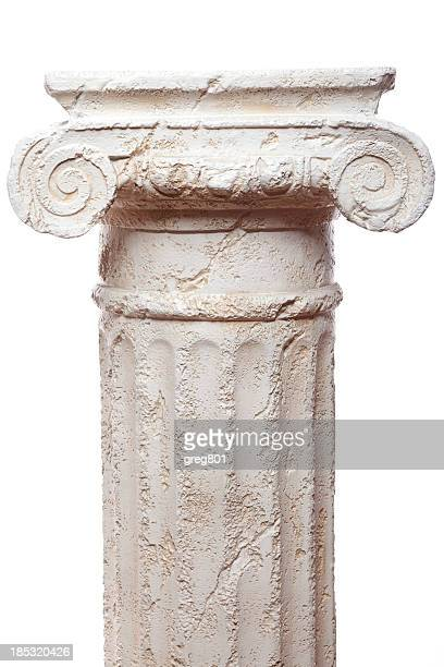 Classical scroll architectural pillar against white backdrop